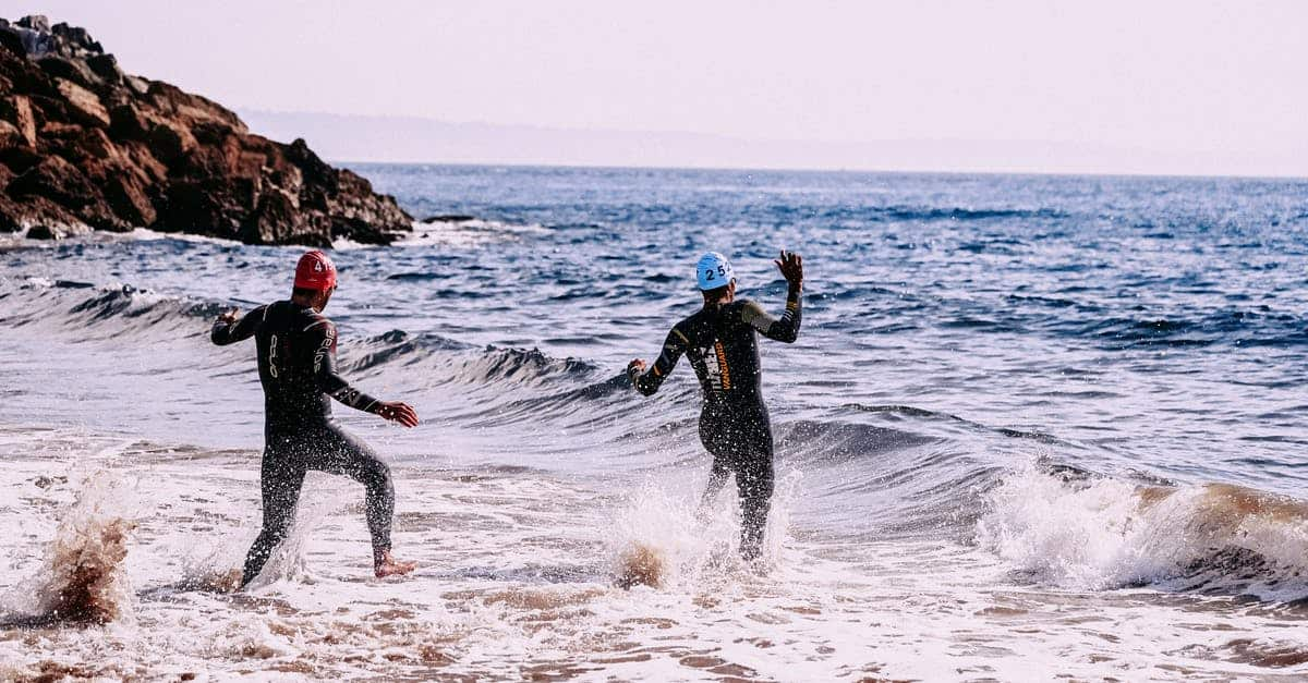 A man in a wet suit is surfing in the ocean